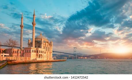 Ortakoy mosque and Bosphorus bridge at amazing sunset - Istanbul, Turkey