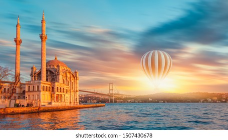 Ortakoy mosque and Bosphorus bridge with Hot air balloon - Istanbul, Turkey.