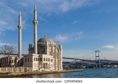 Ortakoy Mosque known also as Mecidiye Mosque, with the Bosphorus Bridge connecting European continent to Asian continent, in the background, in Istanbul, Turkey