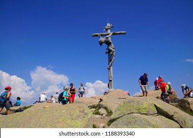 ORTESEI, ITALY - AUG 5, 2018 - Santa Croce Heiligkreuz carved sculpture on a mountain promontory in the Val Gardena Dolomites Alps, Italy