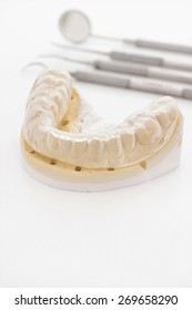 Orthodontic or maxillary cast with a silicone rubber bruxism or night guard used in dentistry to prevent teeth grinding