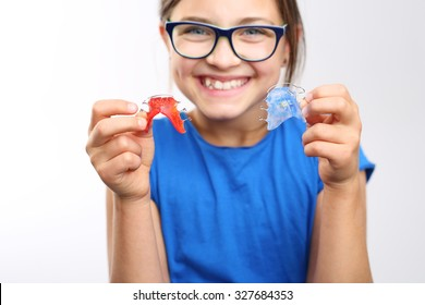 Orthodontics, beautiful smile.Portrait of a little girl with orthodontic appliance .