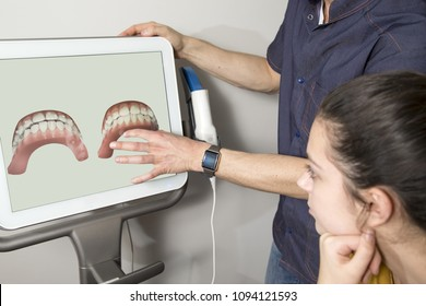 Orthodontist showing tooth scan