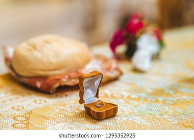 Orthodox baptism ritual accessoires - bread, Bible, and other
