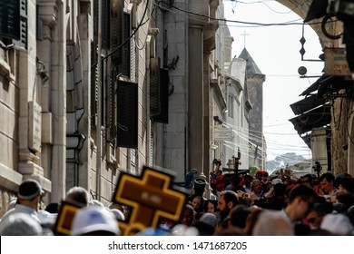 Orthodox believers from different countries during the procession go on Good Friday through the streets of the Old City of Jerusalem, Israel. 03-05-2013