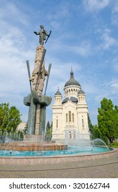 Orthodox Cathedral and national hero Avram Iancu statue in Cluj Napoca, transylvania region of Romania on a sunny summer day. Beautiful church in the center of this eastern european tourist attraction
