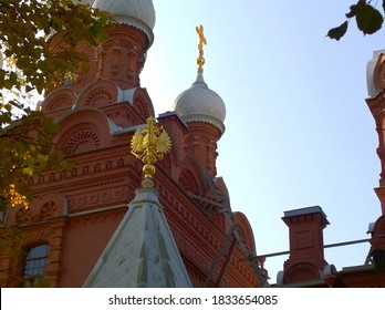 Orthodox Christian Church with white domes, golden crosses and coat of arms of Russia double-headed eagle. Located in Pushkin, suburb of St. Petersburg, Russia. Ancient temple.