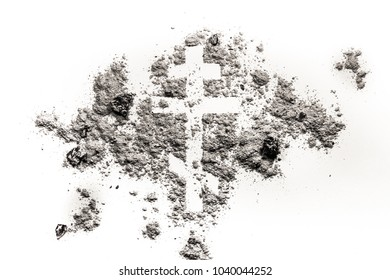 Orthodox christian cross or crucifix symbol made in ash, sand or dust as religion, lent, bible, fasting, absinence or easter concept