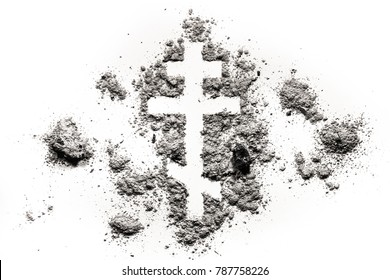 Orthodox christian cross or crucifix symbol made in ash, sand or dust as religion, lent, fasting, absinence concept