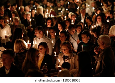 Orthodox Christian worshiper holds candles during an Easter vigil mass in the Cathedral of Archangels Michael and Gabriel in Brussels, Belgium on Apr. 8, 2018