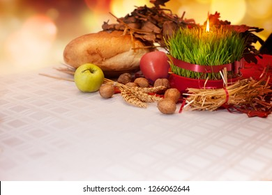 Orthodox Christmas offerings with growing green wheat. Homemade Christmas decoration. Table with Christmas wheat and Yule log.