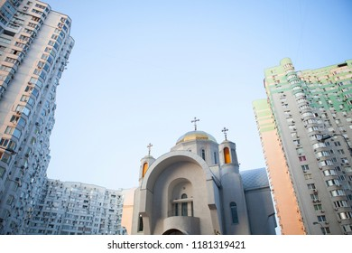 Orthodox church among residential high buildings