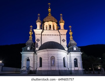 Orthodox Church of Christ's Resurrection in Foros during sunrise time.