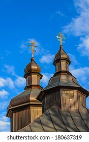 Orthodox church cupolas with colourful crosses against the blue sky