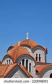 Orthodox church exterior detail of dome with cross and windows.