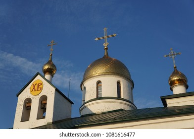 The orthodox church, Holy Trinity Cathedral in Kolpino, Russia. Gold domes with crosses and bells.