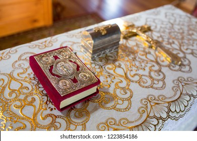 orthodox church interior with bible and candles
