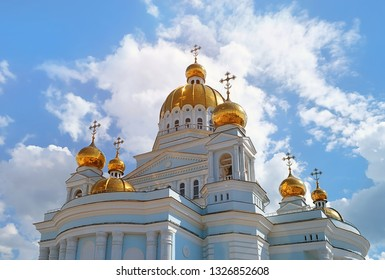 Orthodox Church. large beautiful Orthodox Church with Golden domes against blue sky and clouds. Russia, Saransk city, Cathedral of Holy warrior Feodor Ushakov.