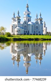 The Orthodox Church is reflected in the surface of the lake