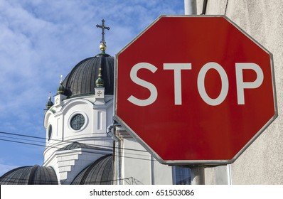 "Orthodox church and the sign ""stop"" symbolizing atheism."