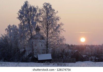 An orthodox church at village in sunset in winter