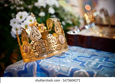 Orthodox church wedding ceremony. Traditional wedding accessories. Bridesmaid and bestman will hold crowns over bride and groom heads during the vow.
