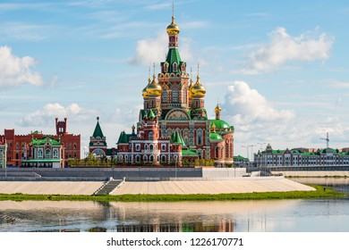 Orthodox Church in Yoshkar-Ola, Russia. Cityscape to new architectural religious building with beautiful golden domes.