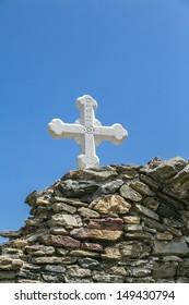 orthodox cross at an ancient wall.