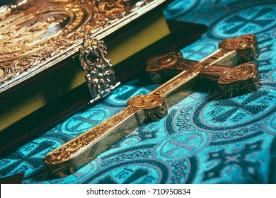 Orthodox cross and the Bible. Shallow depth of field. Focus on the the central part of the cross.