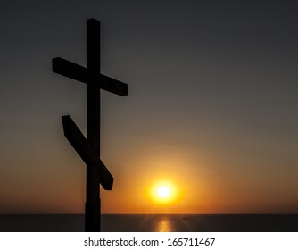 Orthodox cross at sunset