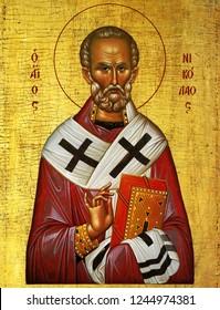 Orthodox curch in Creta, Greece -  Saint Nicholas, orthodox icon painted on stone-wall