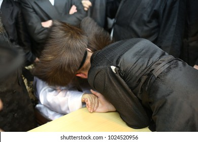 Orthodox hasidic Jewish man receives a blessing from his holy Rebbe/Rabbi.
