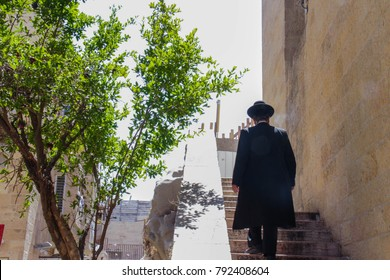 Orthodox Jew Walking up Stairs