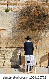 Orthodox Jude is praying at the Wailing wall in Jerusalem, Israel.