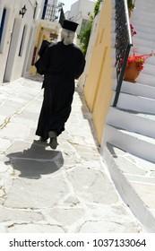 orthodox pope in a typical greek street