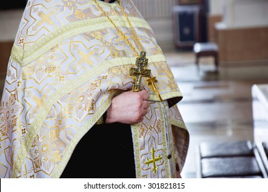 orthodox priest with a cross in church