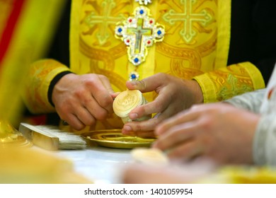 Orthodox priest during the liturgy, Procurion, prosphora. hold communion Throne of the Orthodox Church.