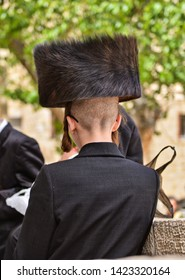 orthodox religious hasidic jews is traditional black outfits with hats in one of jerusalem neighborhood