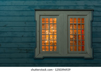 Orthodox window by night. Orthodox wooden window. Poland.