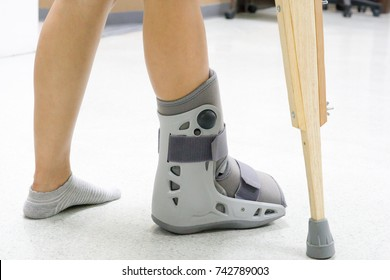 Orthopaedic Boot and crutch to a Patient.