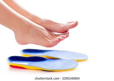 orthopedic insoles and female legs above it