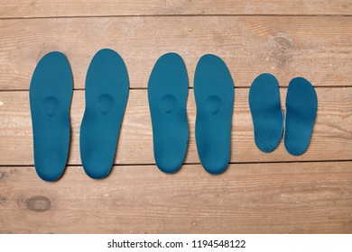orthopedic insoles on wooden boards