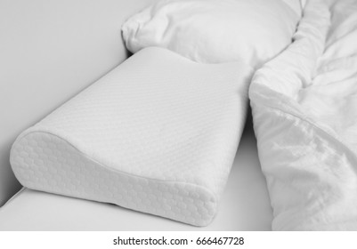 Orthopedic pillow on bed. Physiotherapy concept