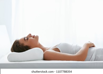 Orthopedic Pillow. Woman Lying In Bed
