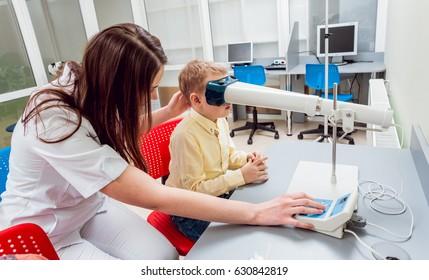Orthoptics. Pleoptics. Doctor explains how to use ophthalmic equipment. Eye training. Vision rehabilitation. Vision recovery.