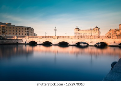 Ortigia, Syracuse, Italy / December 2018: View of the strait of water between mainland Siracusa and Ortigia. View of Umberto I bridge in Syracuse