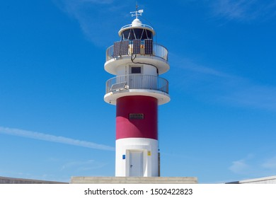 Ortigueira, Spain May 2019. Lighthouse at Cape Ortegal, in Ortigueira, Spain. Figure isolated under blue sky
