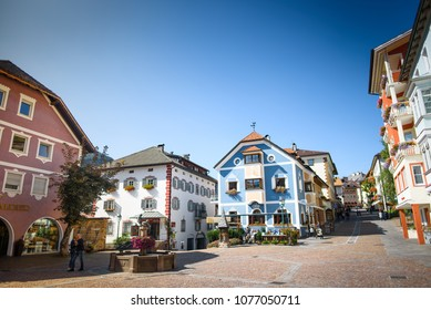 ORTISEI, BOLZANO, ITALY - September 22, 2017: tourists walking in downtown square