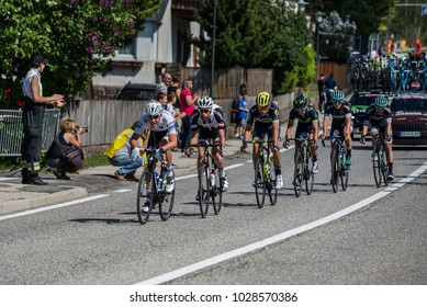Ortisei, Italy May 25, 2017:  Group of professional cyclists , with Bob Jungels in white jersey, during a fast descent in one of the mountain stages of the Tour of Italy 2017.