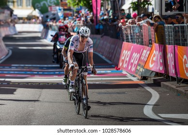 Ortisei, Italy May 25, 2017:  Professional Cyclists Bob Jungels exhausted passes the finish line after a hard montain stage of Tour of Italy 2017  with an uphill finish in Ortisei.